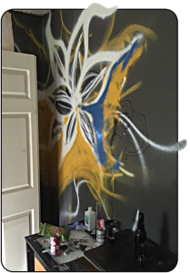 Graffiti scares off retail buyers and drives down the price of an investment property. You can paint over it. It may take several coats of Killz, but you can.