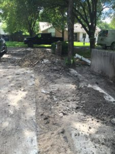 The mess of a driveway that stayed that way for months.