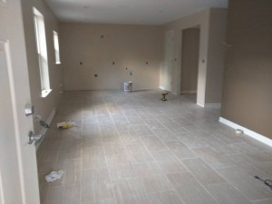 Painted, tile down, trim and doors in...becoming a house!