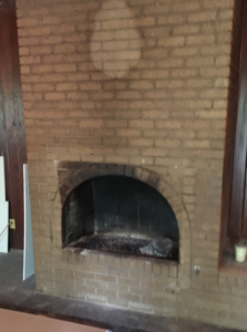 The arched brick fireplace is a great character feature in the living room.