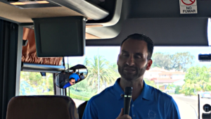 JD Esajian speaking on a bus.