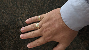 My hand with Mom and Dad's wedding rings.