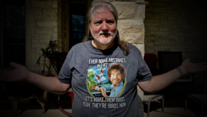 Lee wearing a Bob Ross T-shirt