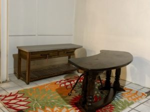 Cool desk, table and rug. Old chair.